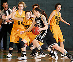 JANUARY 23, 2015 -- Brittany Hernandez #35 of UC-Colorado Springs drives on Bailey Kusser #23 of Black Hills State during their Rocky Mountain Athletic Conference women's basketball game Friday at the Donald E. Young Center in Spearfish, S.D.  In the background are Logan Cowan #44 and Dakota Barrie #32 of Black Hills State.  (Photo by Dick Carlson/Inertia)