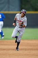Kurt Hoekstra (25) of the Danville Braves hustles towards third base against the Burlington Royals at Burlington Athletic Park on July 12, 2015 in Burlington, North Carolina.  The Royals defeated the Braves 9-3. (Brian Westerholt/Four Seam Images)