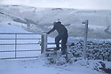 14/01/16<br /> <br /> A walker scales a snow-covered style on Mam Tor in the Derbyshire Peak District near Edale.<br /> <br /> All Rights Reserved: F Stop Press Ltd. +44(0)1335 418365   +44 (0)7765 242650 www.fstoppress.com