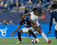 FOXBOROUGH, MA - JUNE 27: Sergio Santos #17 dribbles as Luis Caicedo #27 defends during a game between Philadelphia Union and New England Revolution at Gillette Stadium on June 27, 2019 in Foxborough, Massachusetts.