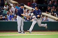 Mobile BayBears third baseman Taylor Ward (7) is congratulated by manager Lou Marson (4) as he rounds third base after hitting a sixth inning home run during a game against the Jacksonville Jumbo Shrimp on April 14, 2018 at Baseball Grounds of Jacksonville in Jacksonville, Florida.  Mobile defeated Jacksonville 13-3.  (Mike Janes/Four Seam Images)