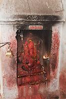 Kathmandu, Nepal.  A Shrine to Ganesh, Shiva's Son, in the Maju Deval Temple to Shiva.  Durbar Square.  The bell, when rung, drives away evil spirits.