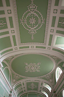 Detail of the stucco ribbons and leaves that decorate the barrel-vaulted ceiling of the long gallery