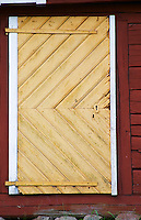 Traditional style Swedish wooden painted house. A door Smaland region. Sweden, Europe.