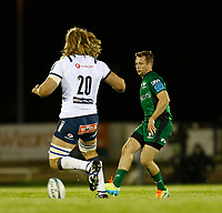 1st October 2021;  The Sportsground, Galway, Ireland; United Rugby Championships, Connacht versus Bulls; Jack Carty kicks a through ball to start a Connacht attack as Jacques du Plessis (Bulls) closes in