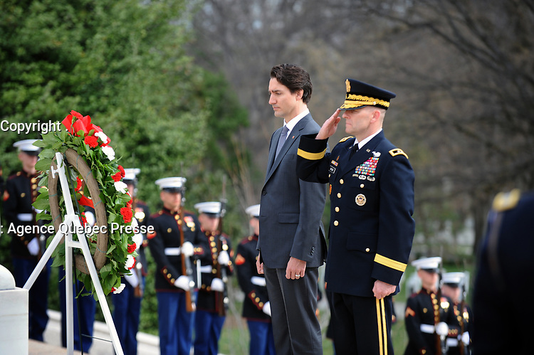 Army Major General Bradley A. Belker, Commanding General, Military District of Washington and The Right Honorable Justin Trudeau, Prime Minister of Canada, pay their respects during wreath laying ceremony at the Tomb of the Unknowns at Arlington National Cemetery. The Prime Minister laid a wreath at the Tomb of the Unknowns at Arlington National Cemetery, Virginia in honor of the Prime Minister's official visit to the United States.  The Official Host for the ceremony, Army Major General Bradley A. Belker, Commanding General, Military District of Washington accompanies the Prime Minister for the ceremony. (Department of Defense photo by Marvin Lynchard)