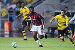 AC Milan Midfielder Franck Kessie (L) in action during the International Champions Cup 2017 match between AC Milan vs Borussia Dortmund at University Town Sports Centre Stadium on July 18, 2017 in Guangzhou, China. Photo by Marcio Rodrigo Machado / Power Sport Images