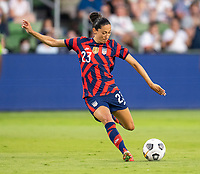 AUSTIN, TX - JUNE 16: Christen Press #23 of the USWNT passes the ball during a game between Nigeria and USWNT at Q2 Stadium on June 16, 2021 in Austin, Texas.