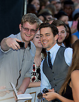 Matt Bomer poses for selfies as he attends The Magic Mike XXL European Film Premiere at Vue, Leicester Square, London, England on 28 June 2015. Photo by Andy Rowland.