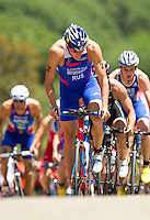 27 MAY 2012 - MADRID, ESP - Alexander Bryukhankov (RUS) of Russia (centre) leads the front pack during the bike at the elite men's 2012 World Triathlon Series round in Casa de Campo, Madrid, Spain (PHOTO (C) 2012 NIGEL FARROW)