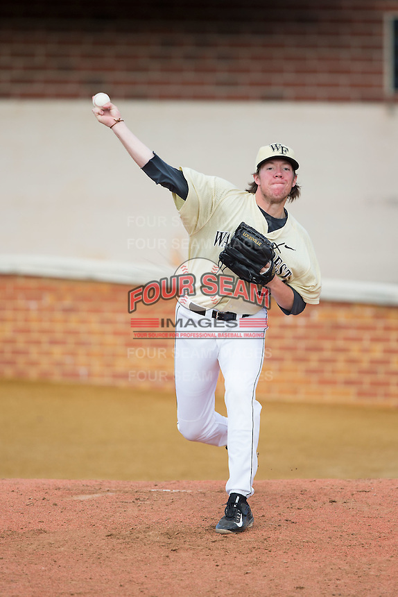 Chris Farish (32) of the Wake Forest Demon Deacons throws in the bullpen prior to the game against the UConn Huskies at Wake Forest Baseball Park on March 17, 2015 in Winston-Salem, North Carolina.  The Demon Deacons defeated the Huskies 6-2.  (Brian Westerholt/Four Seam Images)