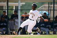 GCL Pirates third baseman Ke'Bryan Hayes (6) slides safely into home to score a run during the first game of a doubleheader against the GCL Yankees 2 on July 31, 2015 at the Pirate City in Bradenton, Florida.  GCL Pirates defeated the GCL Yankees 2 2-1.  (Mike Janes/Four Seam Images)