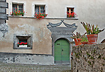 House in Bondo with painted with unusual decorations of fish on the facade, a Bregaglia Swiss Valley town