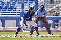 Toronto Blue Jays Austin Martin (80) leads off first base during a Major League Spring Training game against the Pittsburgh Pirates on March 1, 2021 at the TD Ballpark in Dunedin, Florida.  (Mike Janes/Four Seam Images)