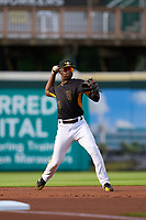 Bradenton Marauders infielder Norkis Marcos (3) throws to first base during a game against the Fort Myers Mighty Mussels on May 6, 2021 at LECOM Park in Bradenton, Florida.  (Mike Janes/Four Seam Images)