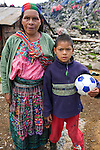 A mother and her son in their village in Chuatuj, Western Highlands, Guatemala