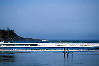 People walking on the Beach at Cox Bay near Long Beach and Tofino, on Vancouver Island, British Columbia, Canada