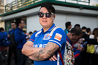 Shen Went, 35, a fan of Chinese Super League football team Shanghai Shenhua wait outside the Worker's Stadium in Beijing before their team's game with Beijing Guo'an. 2nd April, 2017.