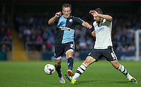 Nikolay Bodurov of Fulham tackles Garry Thompson of Wycombe Wanderers during the Capital One Cup match between Wycombe Wanderers and Fulham at Adams Park, High Wycombe, England on 11 August 2015. Photo by Andy Rowland.