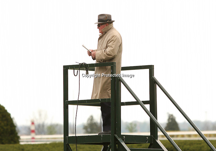 08 April 2010.  Keeneland's starter checks out the action before the 6th race.
