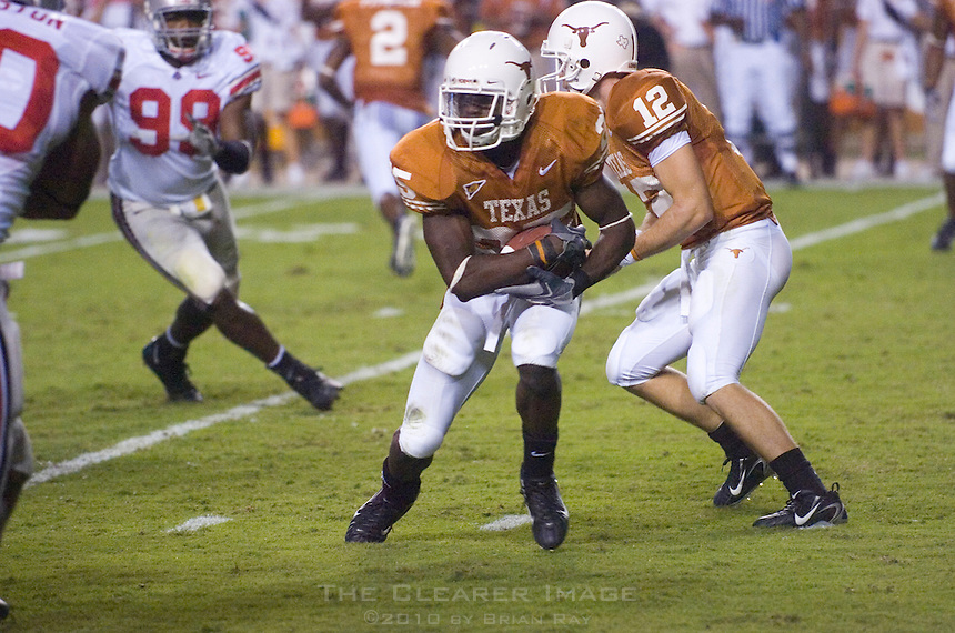 09 September 2006: Texas back Jamaal Charles (#25) takes a handoff from quarterback Colt McCoy (#12) during the Longhorns game against the Ohio State Buckeyes at Darrell K Royal Memorial Stadium in Austin, TX.