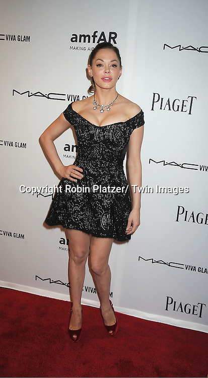 Rose McGowen in Marc Jacobs black dress attends the amfAR Inspiration Gala on June 7, 2012 at The New YOrk Public Library in New York City. The honorees were Fergie and Robert Duffy/ Marc Jacobhs International and the Scissor Sisters performed.