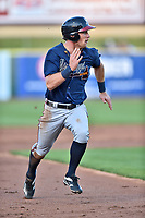 Mississippi Braves center fielder Connor Lien (5) runs to third base during a game against the Tennessee Smokies at Smokies Stadium on April 12, 2017 in Kodak, Tennessee. The Braves defeated the Smokies 6-2. (Tony Farlow/Four Seam Images)