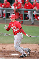 DJ Peterson #33 of the University of New Mexico Lobos bats against the Arizona State Sun Devils  in game two of the 2011 season opening series on February 20, 2011 at Packard Stadium, Arizona State University, in Tempe, Arizona..Photo by:  Bill Mitchell/Four Seam Images.