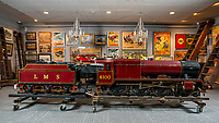 BNPS.co.uk (01202 558833)<br /> Pic: MaxWillcock/BNPS<br /> <br /> Pictured: A remarkably detailed, functioning model steam engine is tipped to sell for £50,000 after attracting worldwide interest from train enthusiasts.<br /> <br /> The maroon 10.25ins gauge model of the London Midland and Scottish tender locomotive No 6100 'Royal Scott' was built in Bedfordshire in 1965.<br /> <br /> It underwent a significant restoration in 1972 and is still in a 'high quality' condition half a century later.<br /> <br /> The 8ft long locomotive weighs one tonne and has a steel boiler, a coal compartment, brakes, fitted steps, handrails and railway lamps.