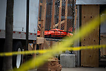 The body of COVID-19 victim is wheeled to a refrigerated trailer used as a temporary morgue outside of Wyckoff Heights Medical Center in the Brooklyn borough of New York City on April 5, 2020.  Photograph by Michael Nagle