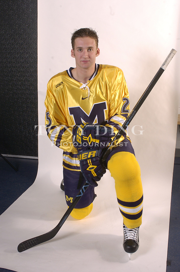 .Michigan Hockey player portrait taken at Yost Ice Arena in Ann Arbor, Mich on Monday, October 4, 2004. (Photo by TONY DING / Daily).Sophomore defender Tim Cook (25)..Michigan Hockey player portrait taken at Yost Ice Arena in Ann Arbor, Mich on Monday, October 4, 2004. (Photo by TONY DING / Daily).