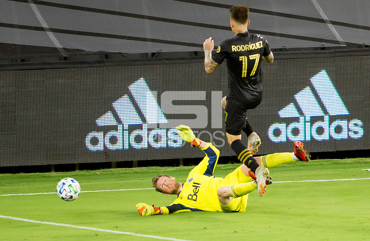 LOS ANGELES, CA - SEPTEMBER 23: Bryan Meredith #1 GK of the Vancouver Whitecaps make a save defending against  Diego Rossi #9 during a game between Vancouver Whitecaps and Los Angeles FC at Banc of California Stadium on September 23, 2020 in Los Angeles, California.