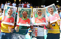 Portgual fans dressed as Panini stickers of their players inside the Arena Fonte Nova