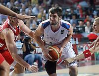 Stefan MARKOVIC (Serbia)  passes Ersan ILYASOVA (Turkey) and Sinan GULER (Turkey) during the semi-final World championship basketball match against Turkey in Istanbul, Serbia-Turkey, Turkey on Saturday, Sep. 11, 2010. (Novak Djurovic/Starsportphoto.com) .