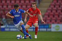 Haydon Roberts of Brighton & Hove Albion (U23s) battles with Danny Johnson of Leyton Orient during the EFL Trophy behind closed doors match between Leyton Orient and Brighton & Hove Albion Under 21s at the Matchroom Stadium, London, England played without supporters able to attend due to ongoing covid-19 government guidelines on 8 September 2020. Photo by Vince  Mignott.