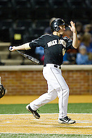 Andrew Williams (16) of the Wake Forest Demon Deacons follows through on his swing against the North Carolina Tar Heels at Wake Forest Baseball Park on March 9, 2013 in Winston-Salem, North Carolina.  The Tar Heels defeated the Demon Deacons 20-6.  (Brian Westerholt/Four Seam Images)