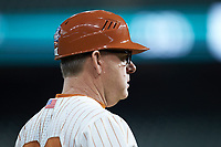Texas Longhorns head coach David Pierce coaches third base during the game against the Missouri Tigers in game eight of the 2020 Shriners Hospitals for Children College Classic at Minute Maid Park on March 1, 2020 in Houston, Texas. The Tigers defeated the Longhorns 9-8. (Brian Westerholt/Four Seam Images)