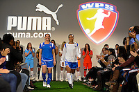 Boston Breakers players Amy Rodriguez and Angela Hucles walk down the runway during the unveiling of the Women's Professional Soccer uniforms at the Event Place in Manhattan, NY, on February 24, 2009. Photo by Howard C. Smith/isiphotos.com