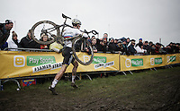 World Champion Wout Van Aert (BEL/Crelan-Vastgoedservice) dropped back to a 30th place at one moment as he had to run half the course to the pits with a broken-off derailleur<br /> <br /> Noordzeecross - Middelkerke 2016