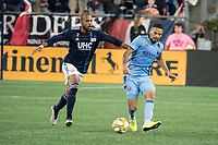 FOXBOROUGH, MA - SEPTEMBER 29: Alexander Callens #6 of New York City FC passes the ball as Teal Bunbury #10 of New England Revolution comes in to tackle during a game between New York City FC and New England Revolution at Gillettes Stadium on September 29, 2019 in Foxborough, Massachusetts.