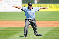 Base umpire Mike Cascioppo calls a runner safe at first during the South Atlantic League game between the Hagerstown Suns and the Rome Braves at State Mutual Stadium on May 2, 2011 in Rome, Georgia.   Photo by Brian Westerholt / Four Seam Images