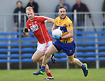 John Hayes of Clare in action against Michael Shields of Cork during their National Football League game at Cusack Park. Photograph by John Kelly.