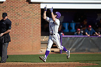 Jordan Sergent (9) of the High Point Panthers points to the sky as he jogs towards home plate after hitting a two-run home run against the NJIT Highlanders at Williard Stadium on February 19, 2017 in High Point, North Carolina. The Panthers defeated the Highlanders 6-5. (Brian Westerholt/Four Seam Images)