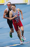 10 SEP 2011 - BEIJING, CHN - Sydney 2000 Olympic Champion Simon Whitfield (CAN) (right) leads Athens 2004 Olympic Champion Bevan Docherty (NZL) on the run during the 2011 Elite Mens ITU World Championship Series Grand Final Triathlon held on the course for the 2008 Beijing Olympics (PHOTO (C) NIGEL FARROW)