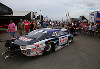 Aug 30, 2014; Clermont, IN, USA; NHRA pro stock driver Jason Line being towed through the pits during qualifying for the US Nationals at Lucas Oil Raceway. Mandatory Credit: Mark J. Rebilas-USA TODAY Sports