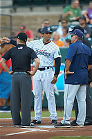 Pulaski Yankees manager Nick Ortiz (center) goes over the ground rules with Princeton Rays manager Danny Sheaffer (29) and umpires Caleb Stone (left) and Colin Brown prior to the Appalachian League game at Calfee Park on July 14, 2018 in Pulaski, Virginia. The Rays defeated the Yankees 13-1.  (Brian Westerholt/Four Seam Images)
