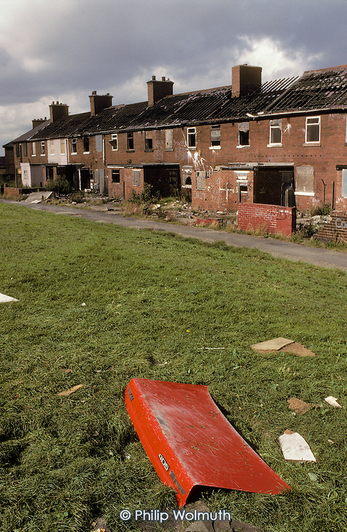 Empty and vandalised housing scheduled for demolition in the ex-mining village of Grimethorpe, South Yorkshire, where the colliery closed in 1992.