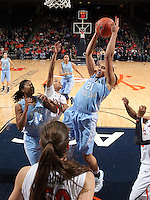 CHARLOTTESVILLE, VA- JANUARY 5: Krista Gross #21 of the North Carolina Tar Heels grabs a rebound next to Virginia Cavalier defenders during the game on January 5, 2012 at the John Paul Jones arena in Charlottesville, Virginia. North Carolina defeated Virginia 78-73. (Photo by Andrew Shurtleff/Getty Images) *** Local Caption *** Krista Gross