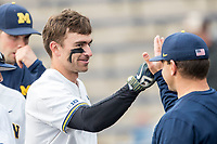 Michigan Wolverines outfielder Jonathan Engelmann (2) returns to the bench after hitting a home run against the Maryland Terrapins on April 13, 2018 in a Big Ten NCAA baseball game at Ray Fisher Stadium in Ann Arbor, Michigan. Michigan defeated Maryland 10-4. (Andrew Woolley/Four Seam Images)