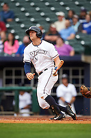 NW Arkansas third baseman Hunter Dozier (9) hits a double during a game against the San Antonio Missions on May 30, 2015 at Arvest Ballpark in Springdale, Arkansas.  San Antonio defeated NW Arkansas 5-1.  (Mike Janes/Four Seam Images)